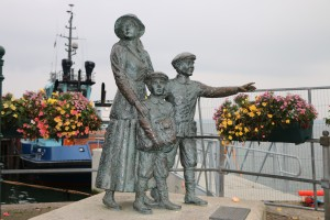 Annie Moore and Brothers Statue. Located Cobh, County Cork, Ireland.